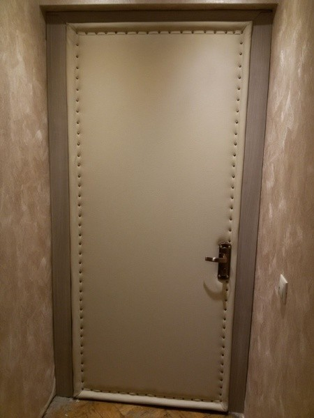 Обивка металлических дверей